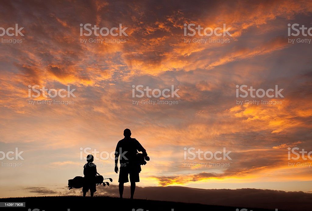 Father and Son Golf Silhouette stock photo