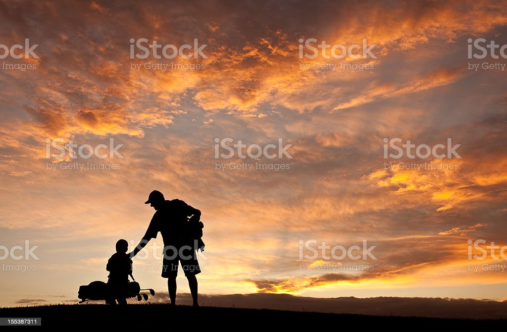 Father and Son Golf Silhouette royalty-free stock photo
