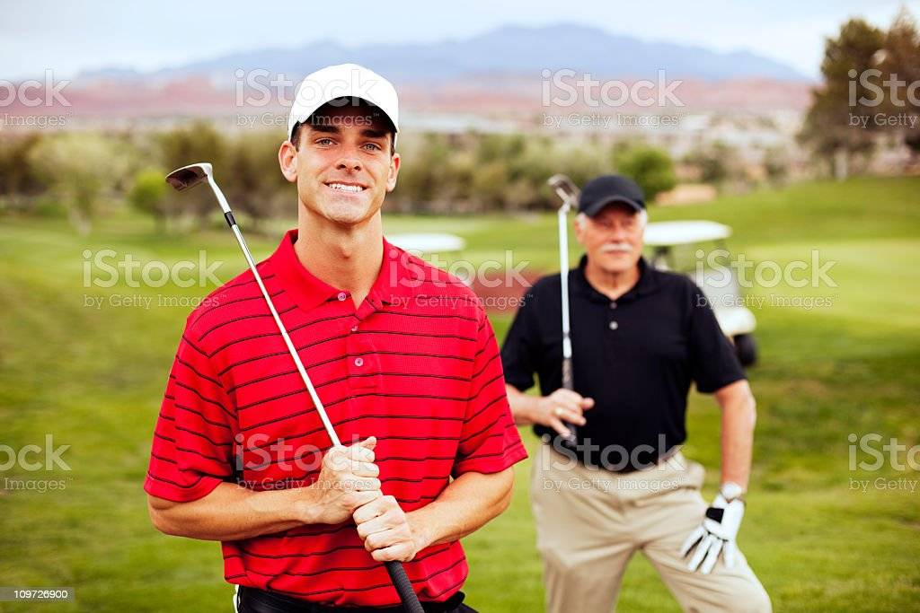 Father and Son Golfers royalty-free stock photo