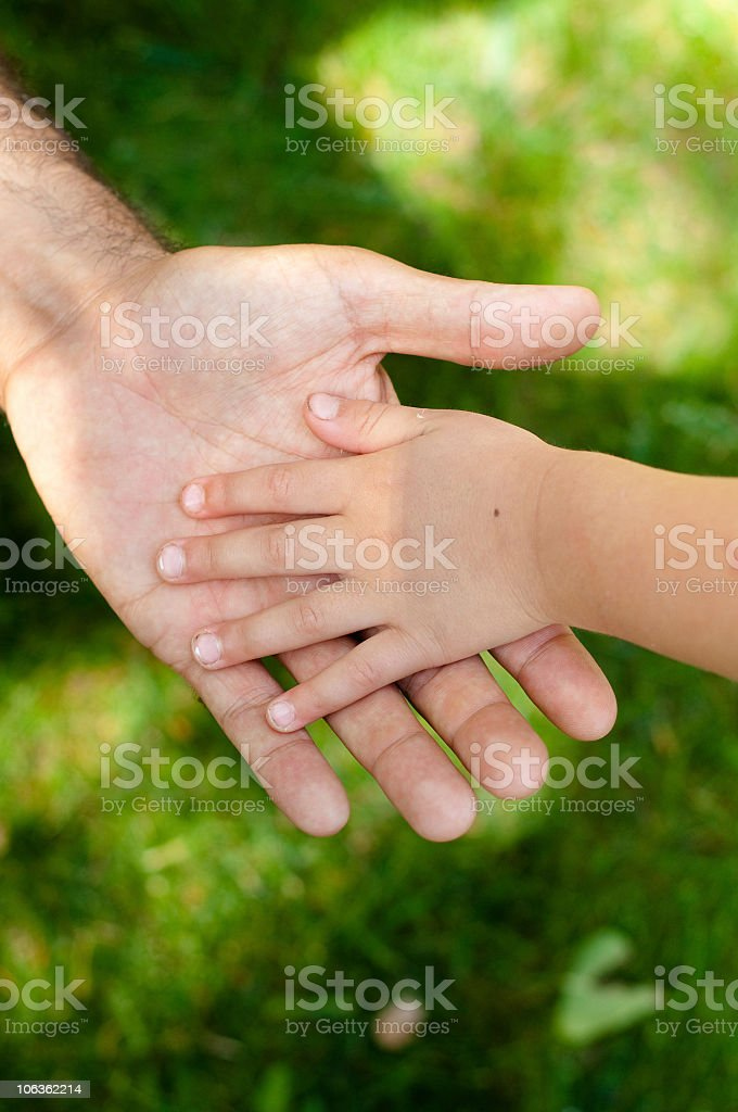 Father and son hands royalty-free stock photo