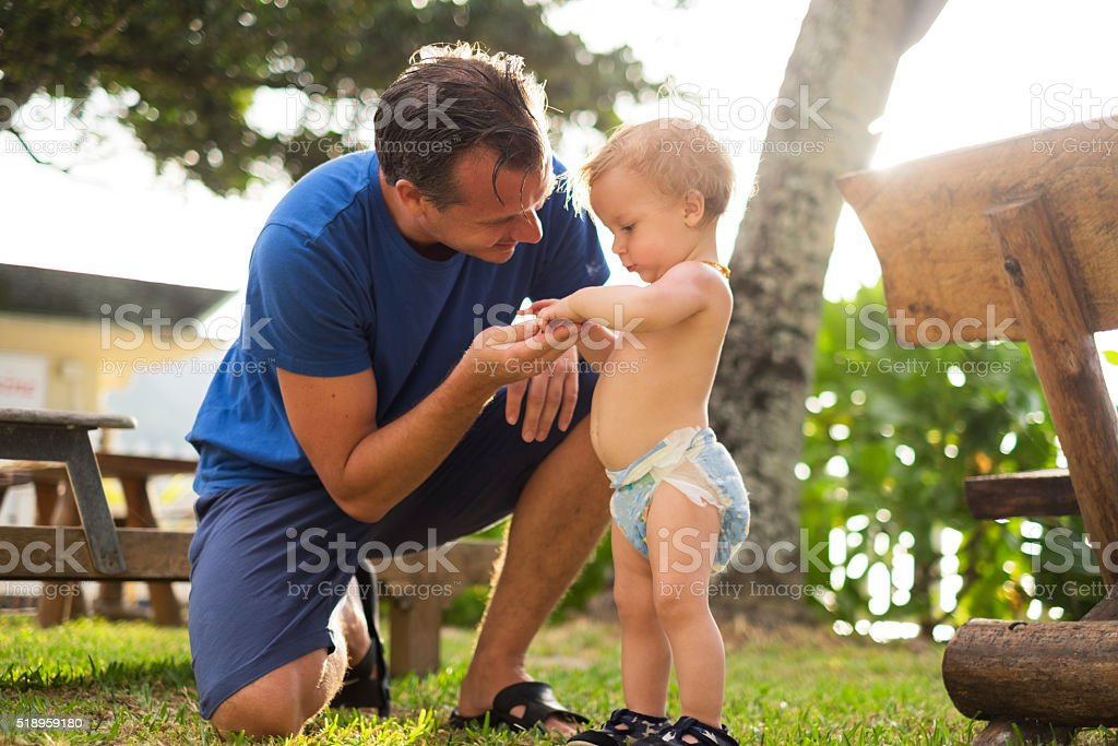 father and son having fun in garden stock photo
