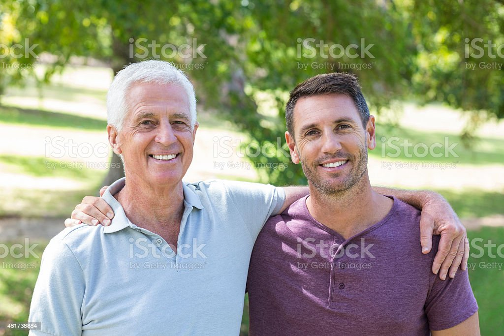 Father and son having fun in the park stock photo