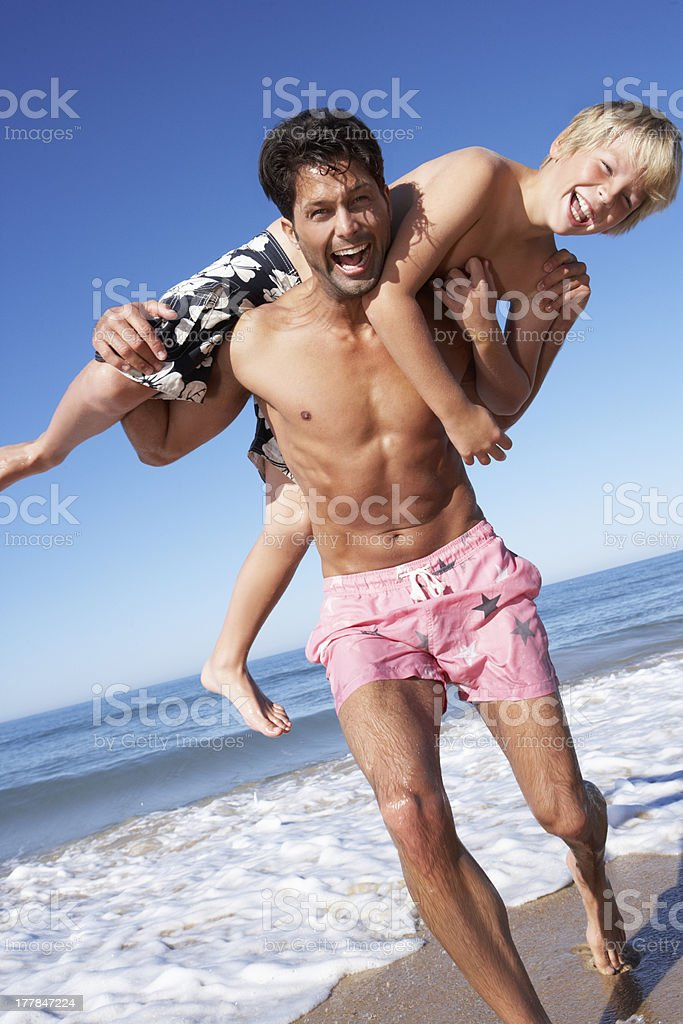Father And Son Having Fun On Beach royalty-free stock photo