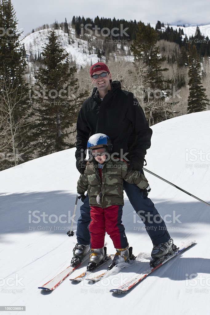 Father and Son Having Fun on the Ski Slopes royalty-free stock photo
