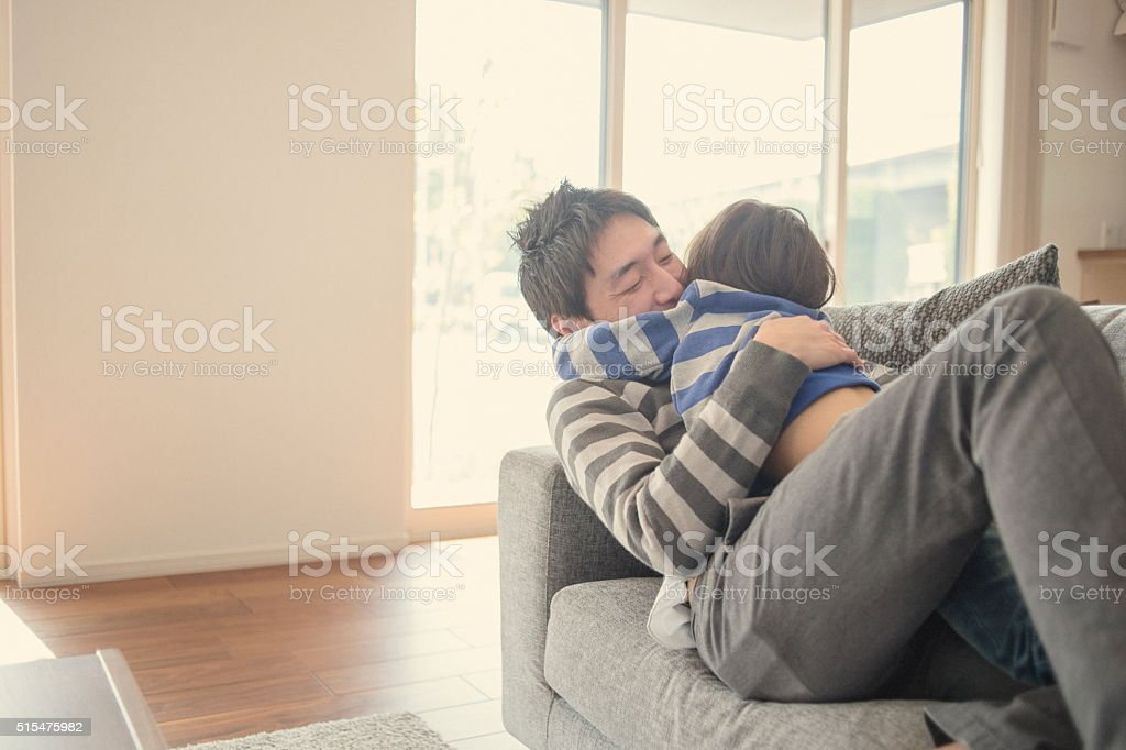 Father and son having fun time at home stock photo