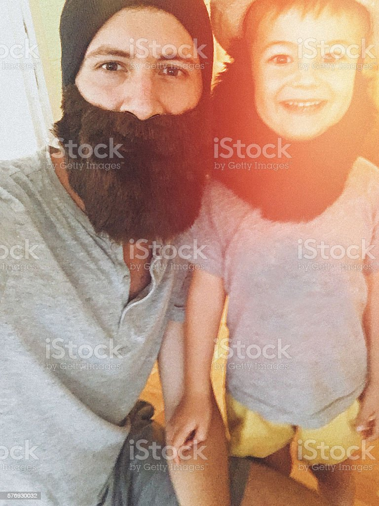 Father and son having fun together stock photo