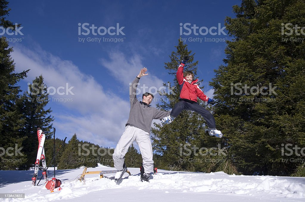 Father and son – high jump on winter day royalty-free stock photo