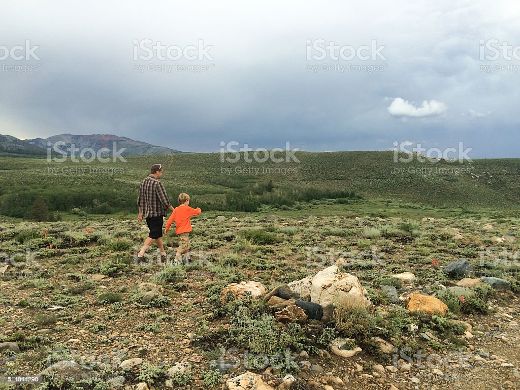 Father and son hiking in the beautiful wilderness of California stock photo