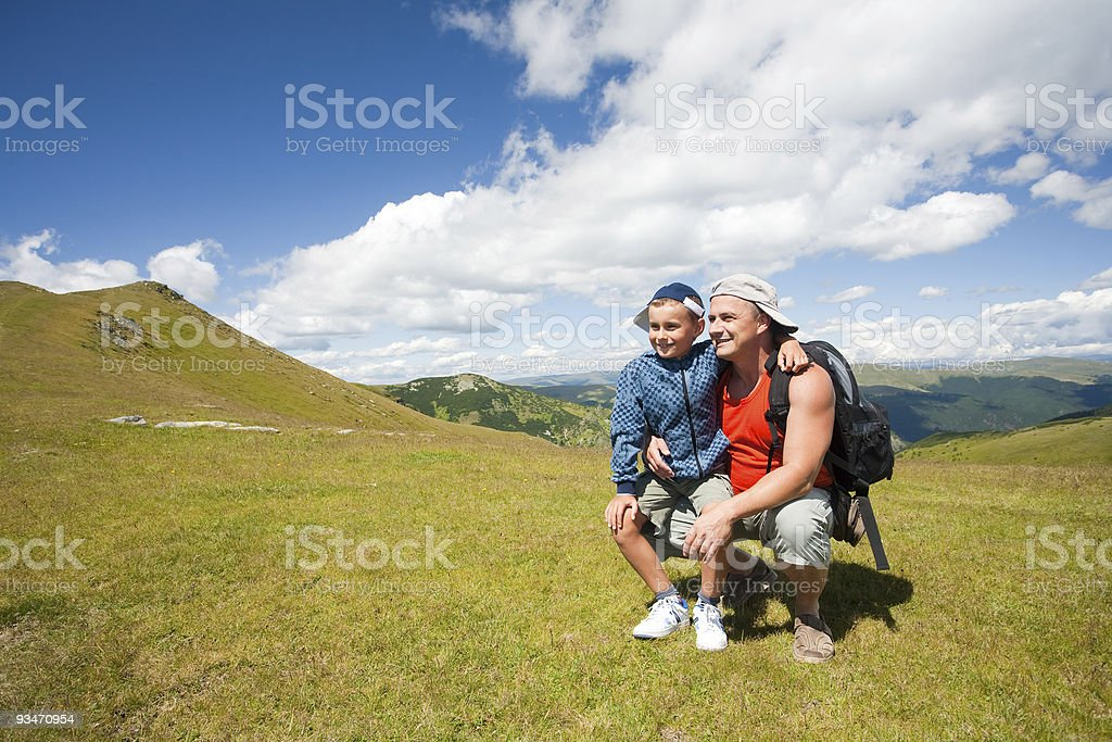 Father and son hiking in the mountains royalty-free stock photo