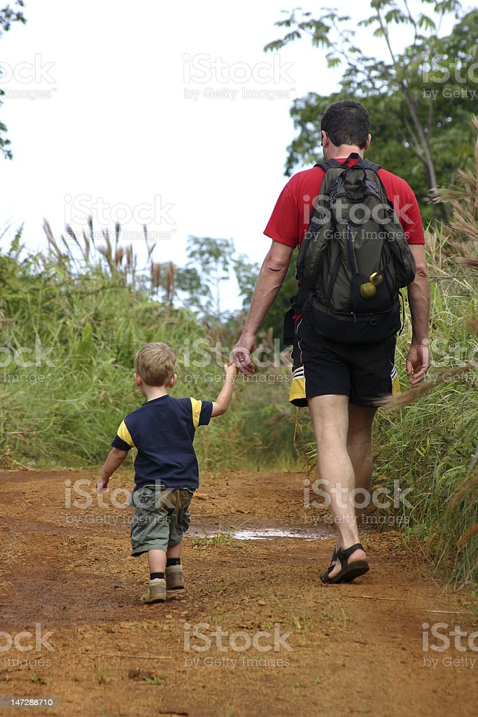 Father and son hiking royalty-free stock photo
