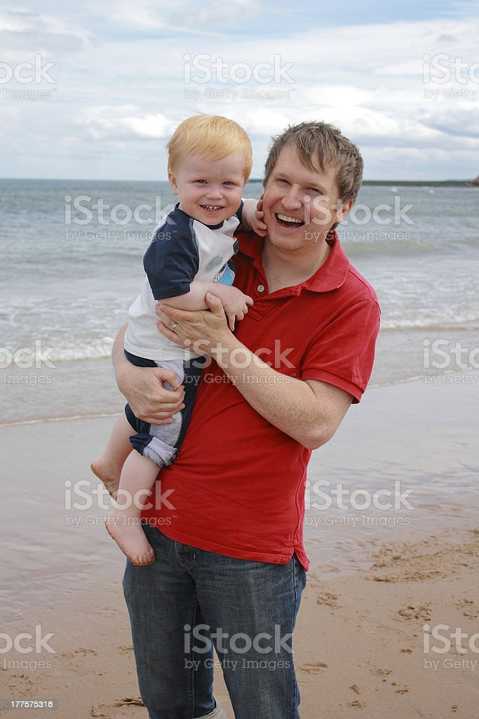 Father and Son Hugging At The Beach royalty-free stock photo