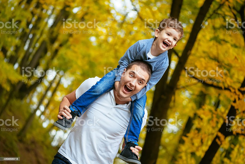Father and son in a park stock photo
