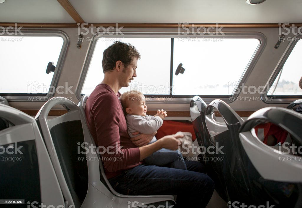 Father and son in a Vaporetto stock photo
