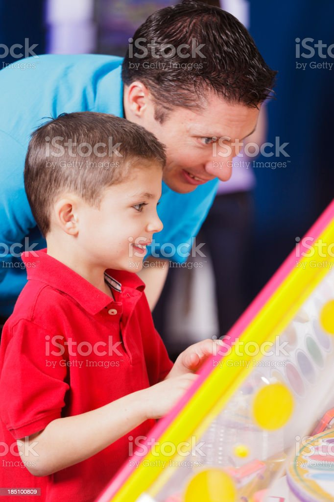 Father and Son in an Amusement Arcade royalty-free stock photo