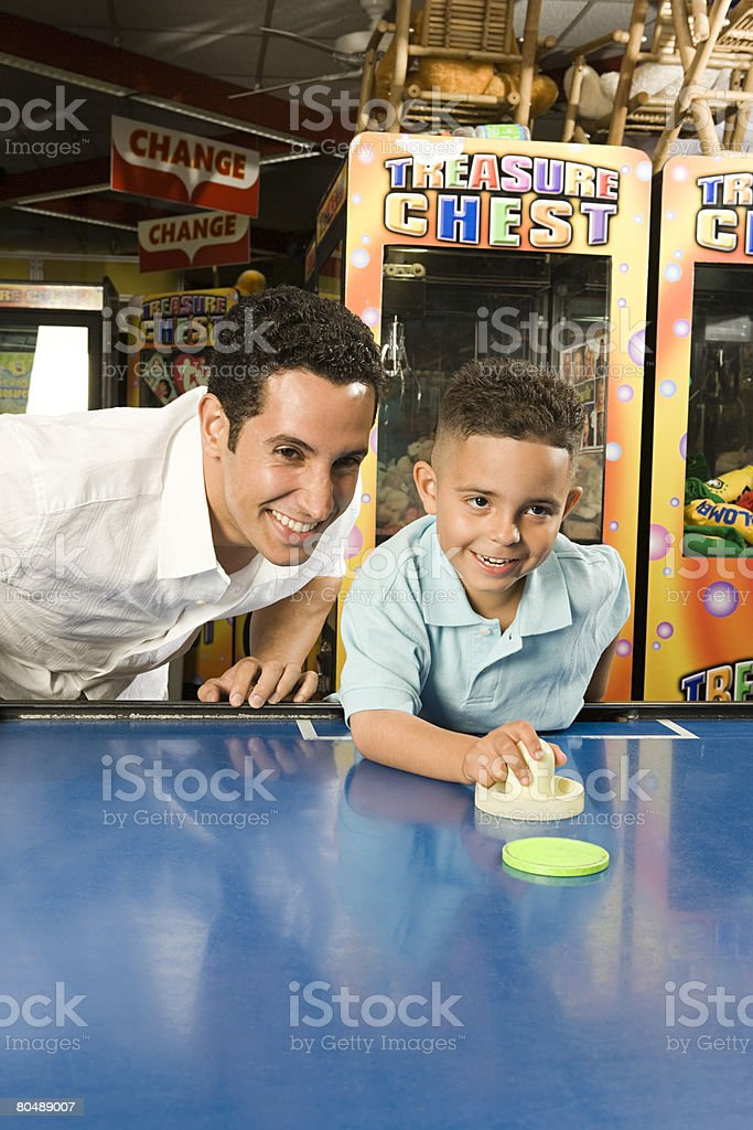 Father and son in arcade stock photo