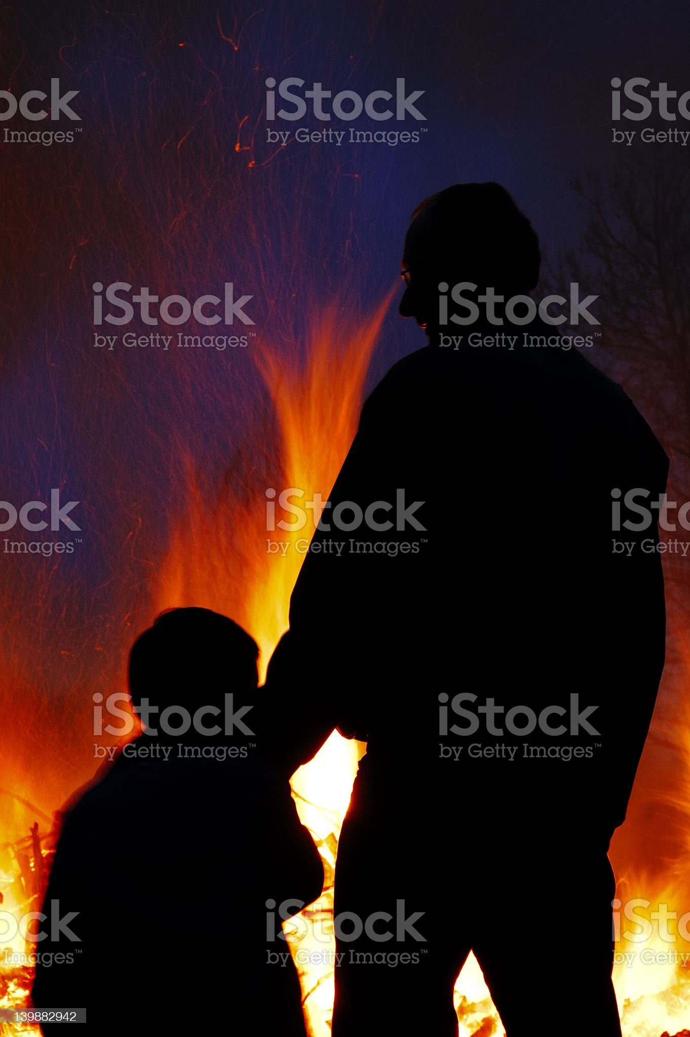 Father and Son in front of fire royalty-free stock photo