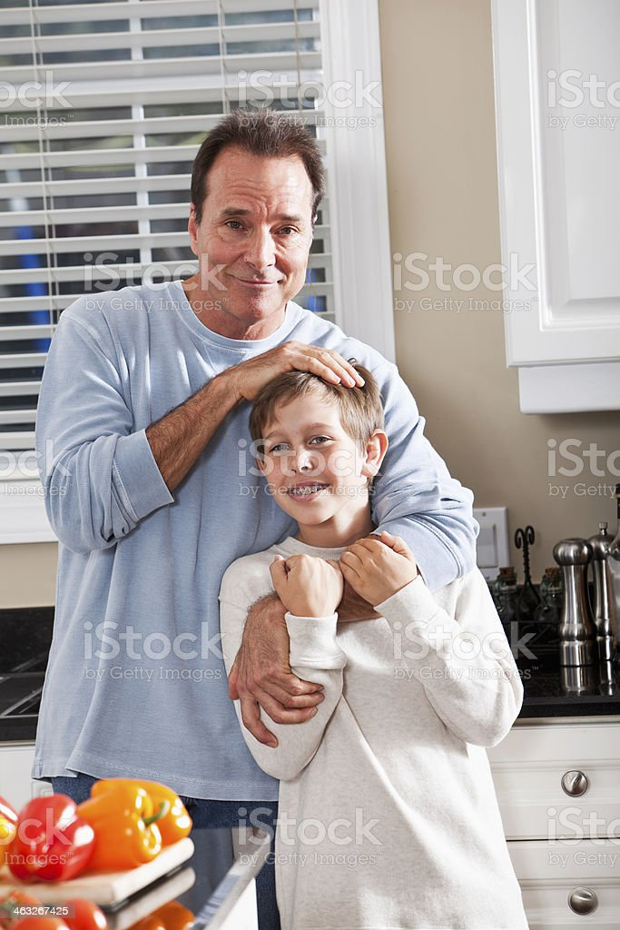Father and son in kitchen stock photo