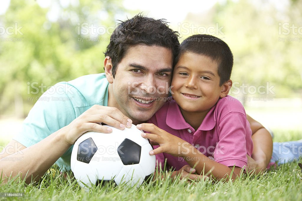Father And Son In Park With Football stock photo