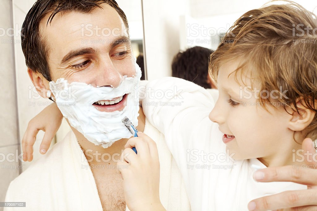 Father and son in the bathroom. royalty-free stock photo