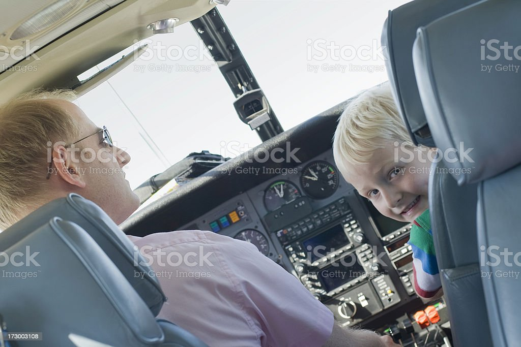 Father and son in the cockpit of a plane royalty-free stock photo