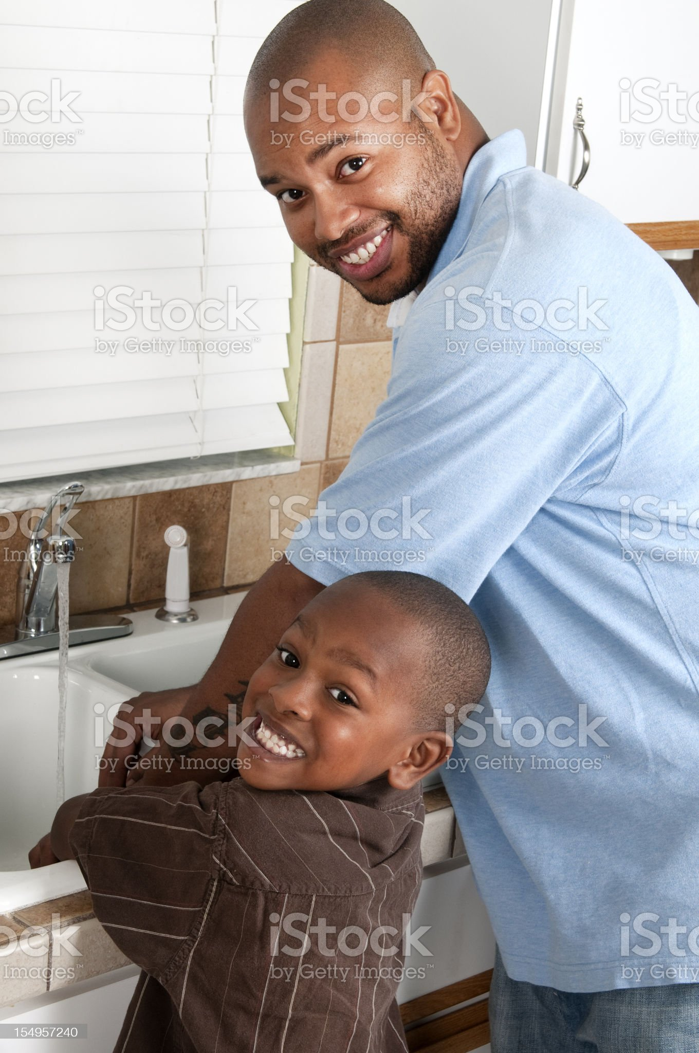 Father and Son in the Kitchen royalty-free stock photo