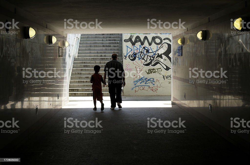 Father and son in underground tunnel stock photo