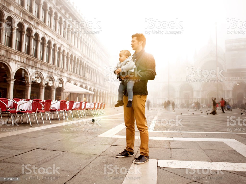 Father and son in Venice stock photo