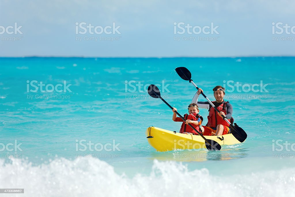 Father and son kayaking stock photo