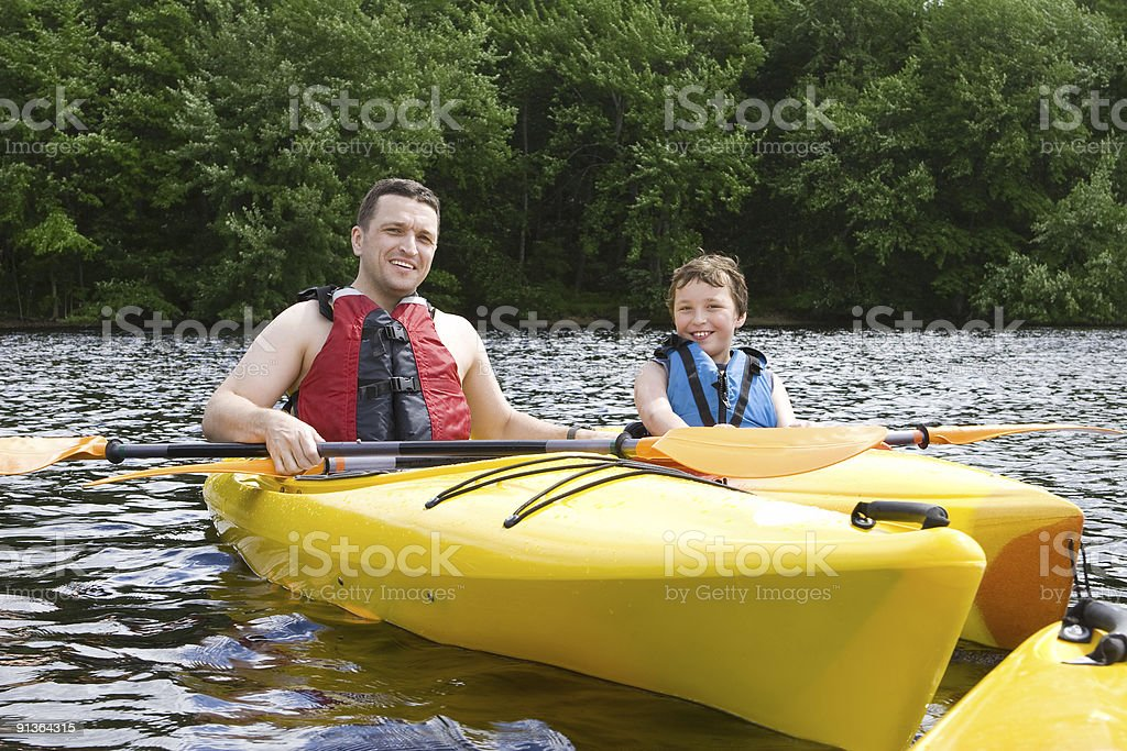 Father and son kayaking royalty-free stock photo