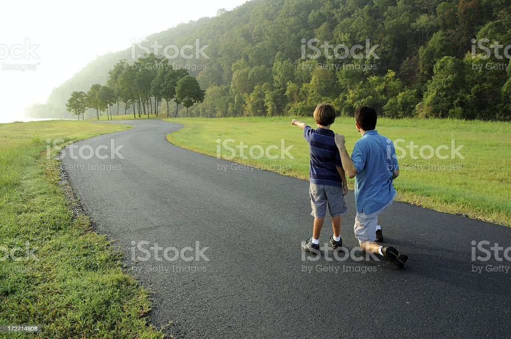 Father and Son Kneeling royalty-free stock photo