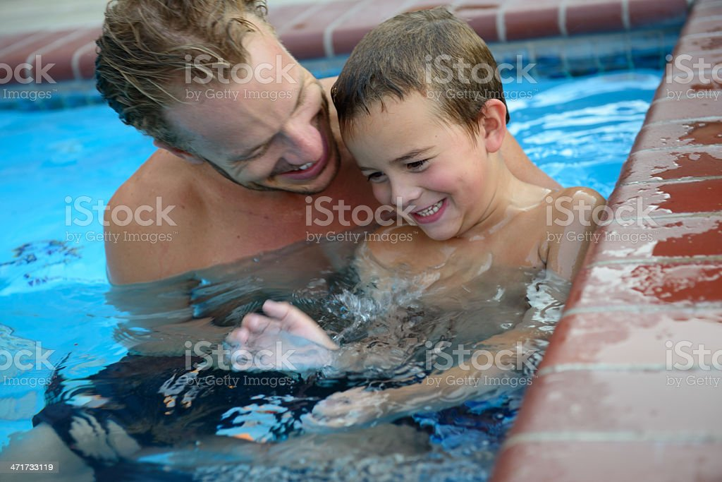 Father And Son Laughing In The Pool royalty-free stock photo