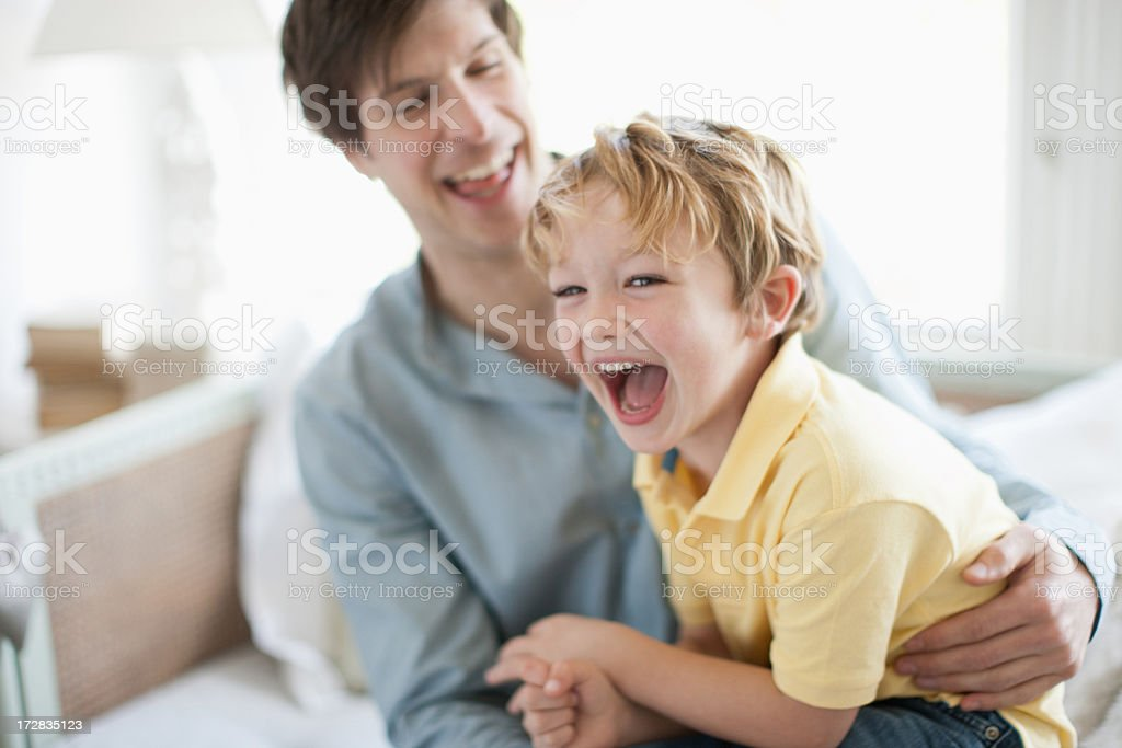 Father and son laughing stock photo