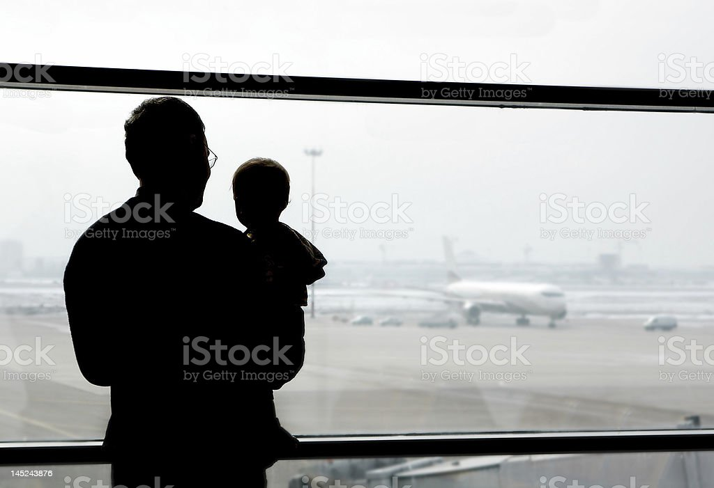 father and son looking at airplanes royalty-free stock photo