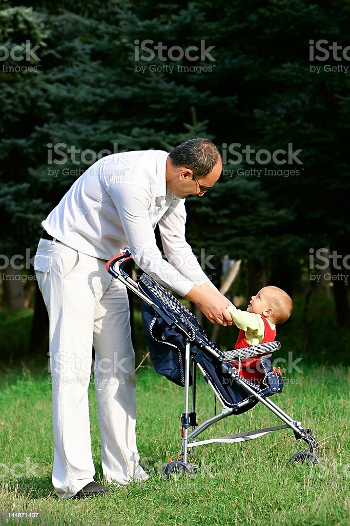 father and son looking at each other royalty-free stock photo