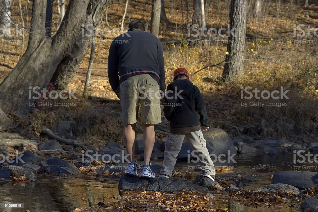 Father and son looking at the water royalty-free stock photo