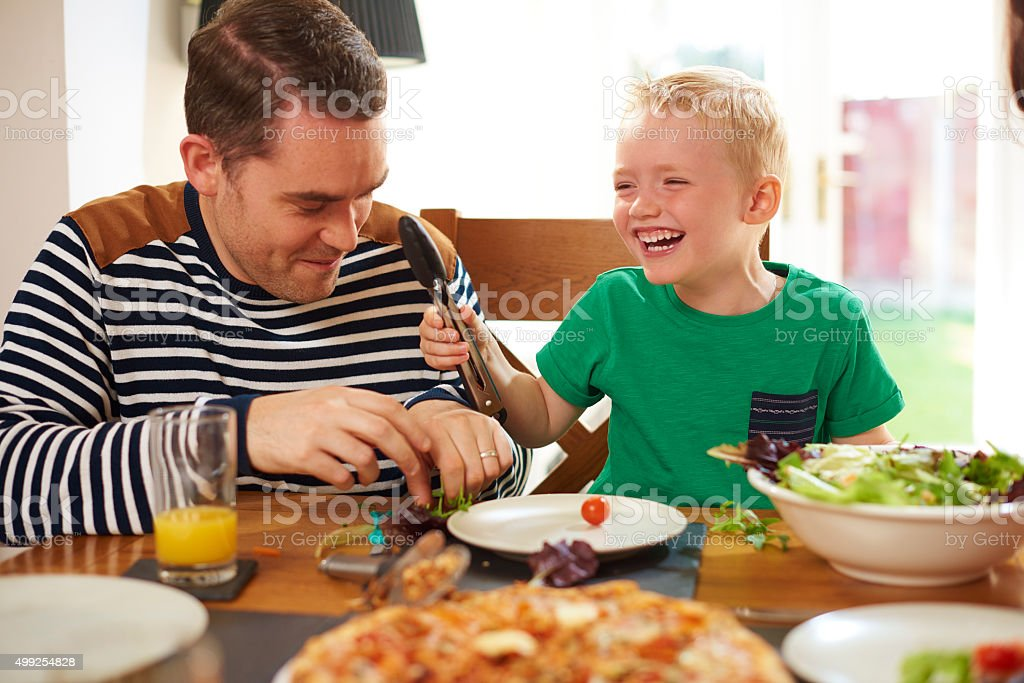 father and son mealtime fun stock photo