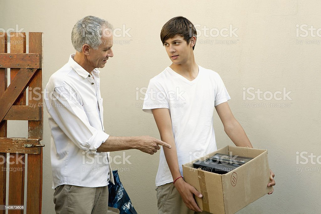 Father and son moving boxes stock photo