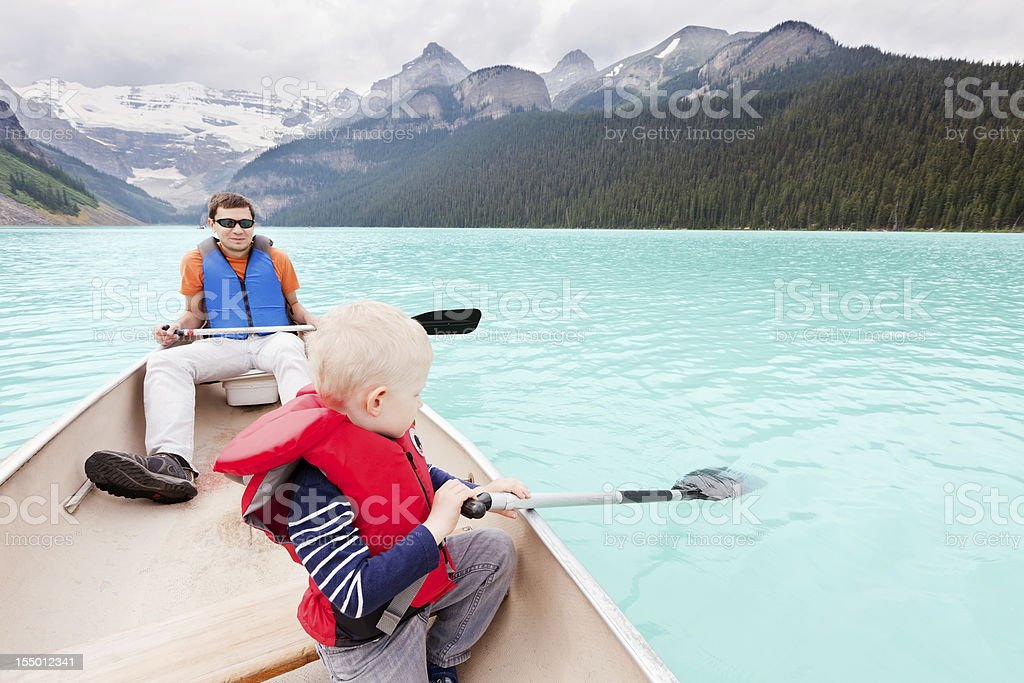 father and son on a lake royalty-free stock photo