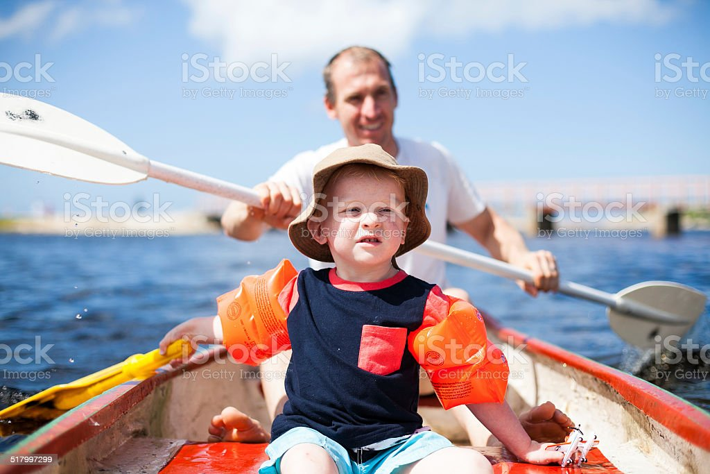 Father and son on a row boat stock photo