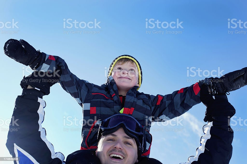 Father and Son on a ski vacation royalty-free stock photo