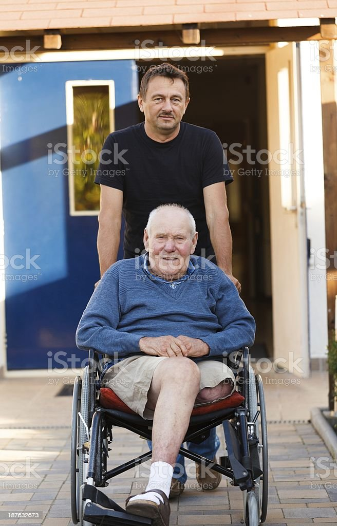 Father and son on a walk royalty-free stock photo