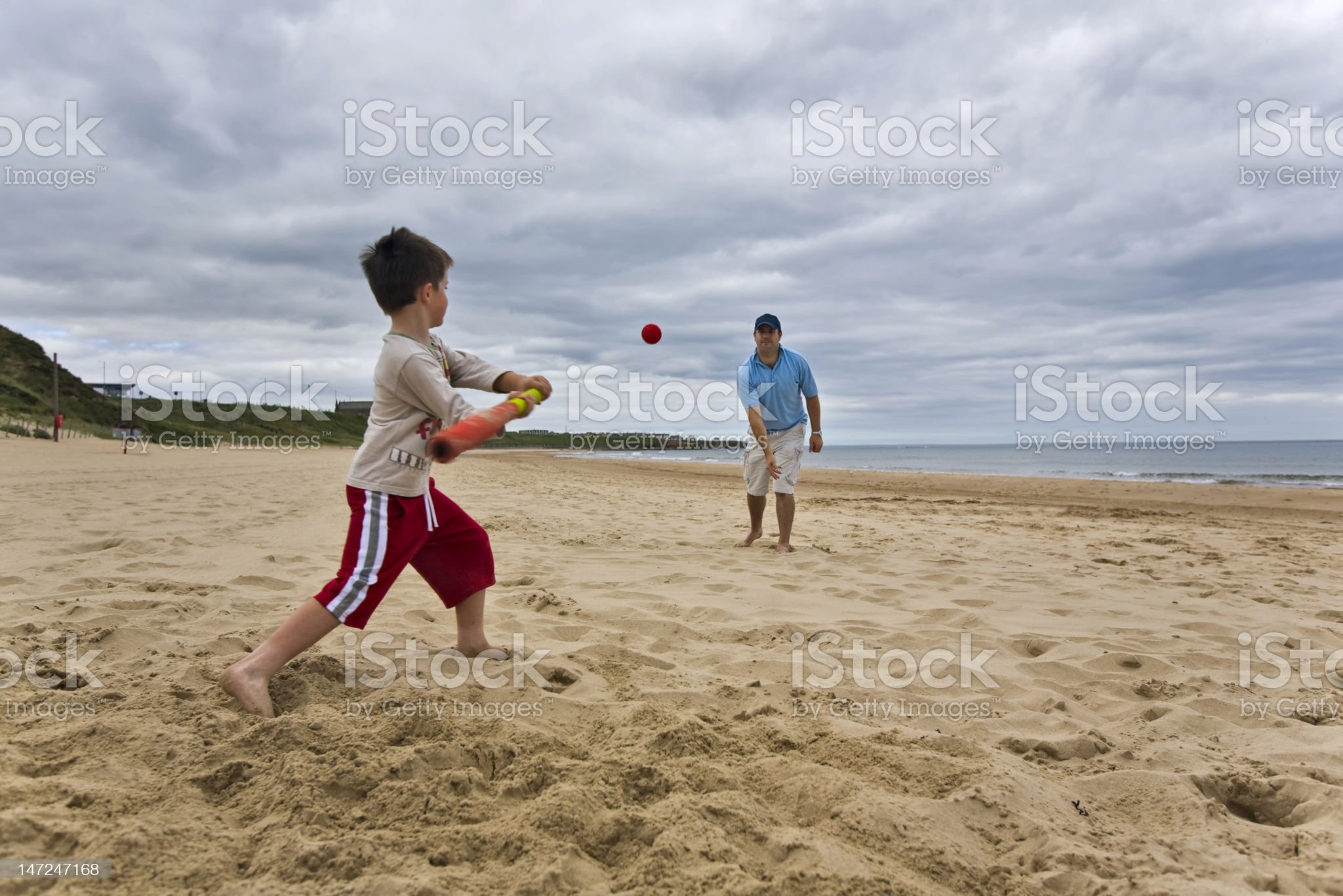 Father and son on beach royalty-free stock photo
