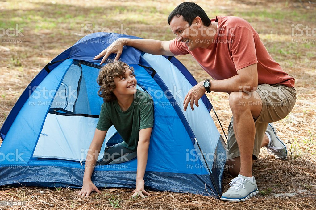 Father and son on camping trip with tent stock photo