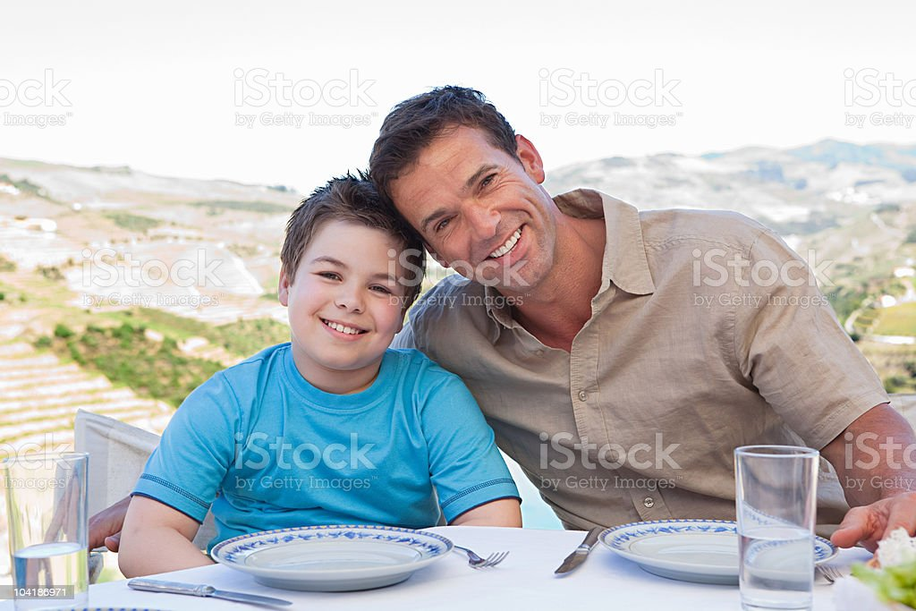 Father and son on holiday royalty-free stock photo