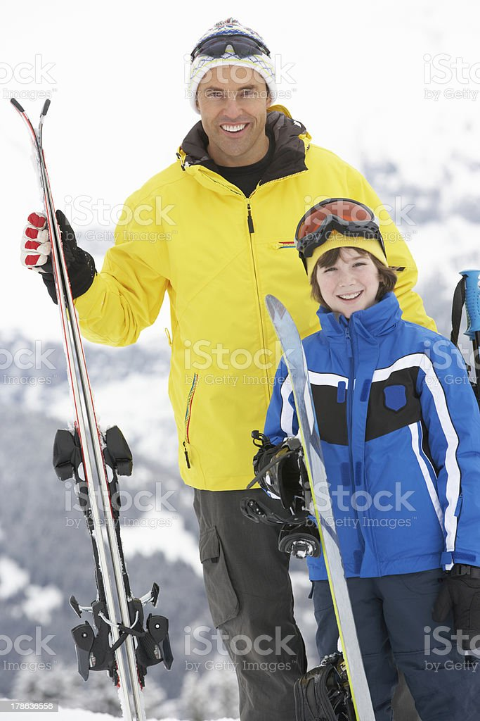 Father And Son On Ski Holiday In Mountains royalty-free stock photo