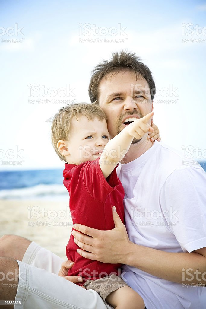 Father and son on the beach royalty-free stock photo