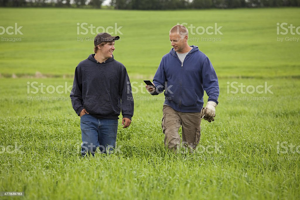 Father and Son on their Farm stock photo