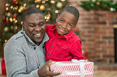 Father and Son Opening Presents