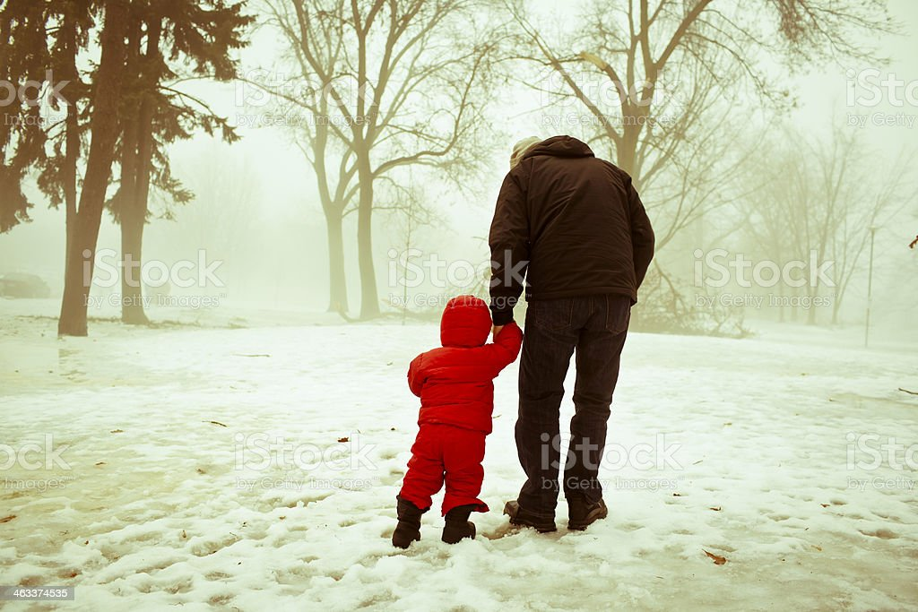 A father and son outdoors in the winter royalty-free stock photo