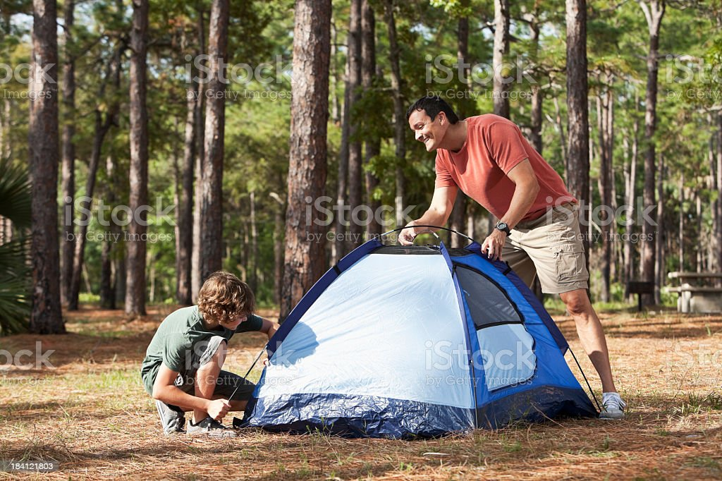 Father and son pitching a tent royalty-free stock photo